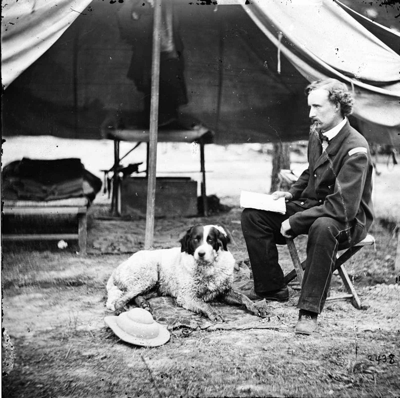 Civil War Dog Camp Comfort  Then-Lt. George Custer with his dog during the Peninsula Campaign, 1862. Throughout history dogs have provided companionship and comfort in the midst of war. Library of Congress photo