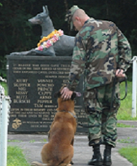 "Military Working Dog Memorial -  The Marine War Dog Memorial is an exact replica of the official memorial at the U. S. Naval Base in Guam, permanently installed at the U. S. Marine Corps War Dog Cemetery on Guam in 1994, the 50th anniversary of the island's liberation. It rests on granite base which is inscribed with the names of the 25 dogs who gave their lives on Guam.  Artist Susan Bahary, a sculptor from California, created the statue which is officially named ""Always Faithful."""