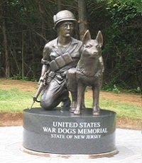 Dedicated  on June 10, 2006, the United States War Dogs Memorial, located guarding  the gateway to the New Jersey Vietnam Veterans' Memorial in Holmdel, New Jersey, consists of a bronze statue of a kneeling Vietnam War soldier and his dog, set on a black granite base.  The memorial was designed by sculptor Bruce Lindsay, Architectural Division Manager at Johnson Atelier in Mercerville, New Jersey. A graduate of Bucknell University, Lindsay's studio is adjacent to Grounds for Sculpture, the 22-acre sculpture park on the grounds of the former New Jersey State Fair.  The U.S. War Dogs Memorial, while directly representing the War Dog Teams of the Vietnam War, honors all our nation's war dogs and their  handlers - past, present and future. http://www.njvvmf.org/United-States-War-Dogs-Memorial